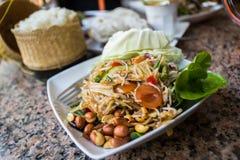 Green papaya salad. Sticky rice vegetables som tam, thai food Stock Photo