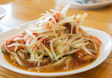 Green papaya salad Thai cuisine spicy delicious : ` SOM TAM ` Thai speak. Background Stock Photos