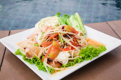 Green papaya salad Thai cuisine spicy delicious. Green Papaya Salad (Som tum Thai) on wood table Stock Image