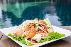 Green papaya salad Thai cuisine spicy delicious. Green Papaya Salad (Som tum Thai) on wood table Stock Photos