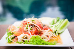 Green papaya salad Thai cuisine spicy delicious. Green Papaya Salad (Som tum Thai) on wood table Royalty Free Stock Images