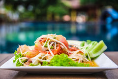 Green papaya salad Thai cuisine spicy delicious. Green Papaya Salad (Som tum Thai) on wood table Royalty Free Stock Image