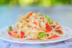 Green papaya salad Thai cuisine spicy delicious. Green Papaya Salad (Som tum Thai) on wood table Royalty Free Stock Photography