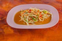 Green papaya salad. Thai food style on wood background Royalty Free Stock Image