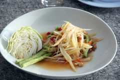 Green papaya salad in white dish. Stock Photography
