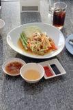 Green papaya salad in white dish. Stock Images