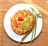 Green papaya salad in white plate Stock Images