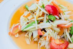 Green papaya saladsomtum. Green papaya salad with dish stock image