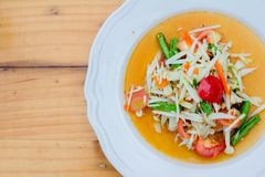 Green papaya saladsomtum. Green papaya salad with dish royalty free stock photo
