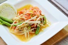 Green papaya spicy salad. Som Tum Royalty Free Stock Photo