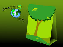 The green paper bag to save the earth Stock Image