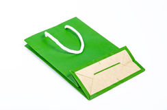 Green paper bag. On white background Stock Images