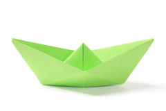 Green paper boat. Closeup of a green paper boat on white background stock photo