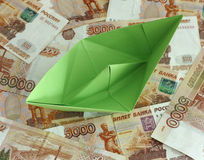 Green paper boat on five thousand rubles banknotes Stock Photos