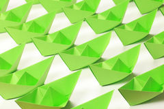 Green paper boats. Several green paper boats on white background royalty free stock photography