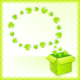Green paper box with clovers greeting card Stock Images