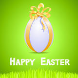 Green paper card with white ornate easter egg Royalty Free Stock Photo