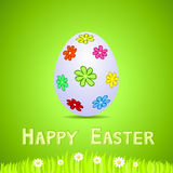 Green paper card with white ornate easter egg Royalty Free Stock Photography