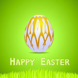 Green paper card with white ornate easter egg Royalty Free Stock Photos