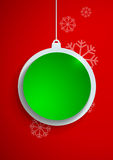 Green Paper Christmas Ball on Red Background Stock Photos