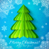 Green paper Christmas tree on blue background. Green vector paper Christmas tree on blue ornate background with snowflakes Royalty Free Stock Photos