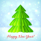 Green paper Christmas tree on blue background. Green paper vector Christmas tree on blue shining background Royalty Free Stock Image