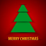 Green paper Christmas tree on red background Stock Photography