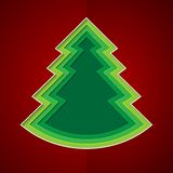 Green paper christmas tree on red background Stock Image