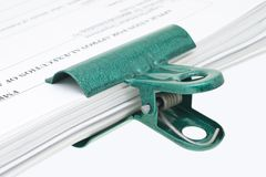 Green paper clip Royalty Free Stock Images