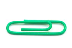 Green paper clips. Isolated on white royalty free stock photos