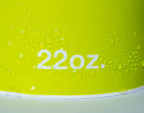 Green paper cup 22 oz with water Stock Images