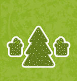 Green paper cut-out christmas tree and gifts Royalty Free Stock Photography