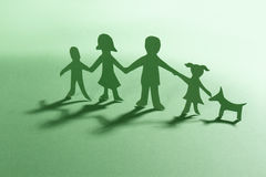 Green Paper family with dog Stock Photography