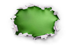 Green paper hole. Breakthrough paper hole with green background, isolated on white Royalty Free Stock Image