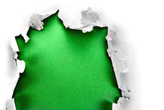 Green paper hole. Breakthrough paper hole with green background, isolated on white Stock Image