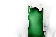 Green paper hole. Breakthrough paper hole with green background, isolated on white Royalty Free Stock Images