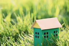 Green paper house on  grass Royalty Free Stock Photography