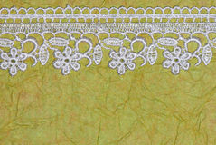 Green paper and lace Stock Photo