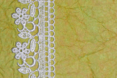 Green paper and lace Stock Images