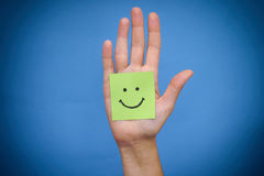 Green paper note with smile in woman palm Stock Images