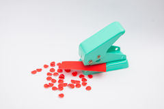 Green paper punches with red paper Royalty Free Stock Images