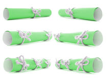 Green paper scrolls tied with handmade cords and knots isolated. Green paper scrolls tied with handmade cords and knots, isolated royalty free stock photo