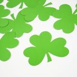 Green paper shamrocks. Royalty Free Stock Photos