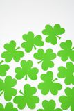 Green paper shamrocks. Stock Photo