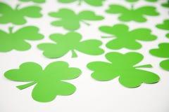 Green paper shamrocks. Stock Image
