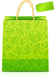 Green paper shopping bag with floral ornament Stock Images