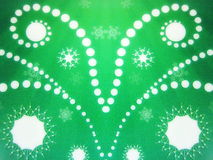 Green paper with snowflakes Stock Images