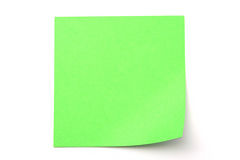 Green paper stick note on white background. Green paper stick note on a white background Royalty Free Stock Image