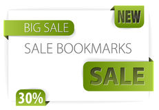 Green paper tags for new discounted items Stock Images