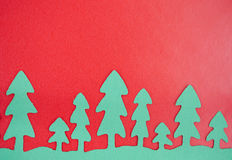 Green Paper Trees With Red Background royalty free stock image